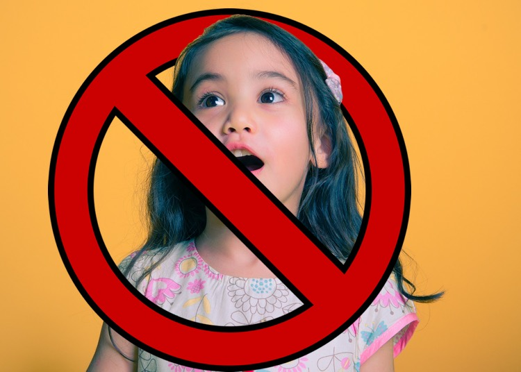Image: Girl singing with 'banned' symbol over it. Universal Music Publishing Group is actively ripping down Facebook cover song videos