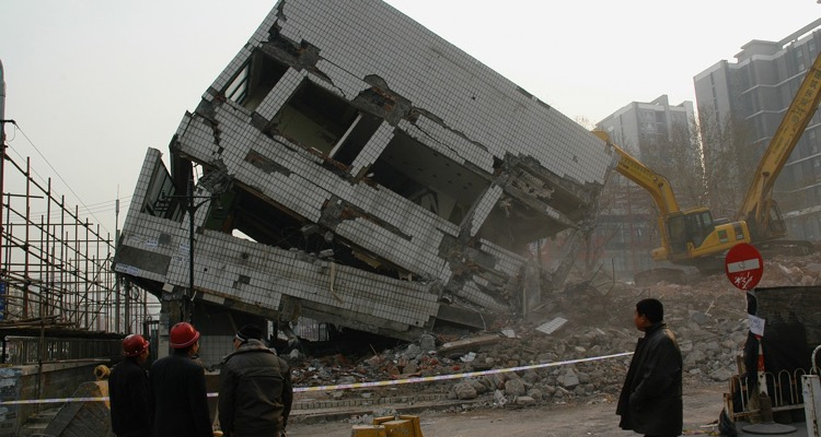 Picture of a collapsing building. Destroy the music industry!