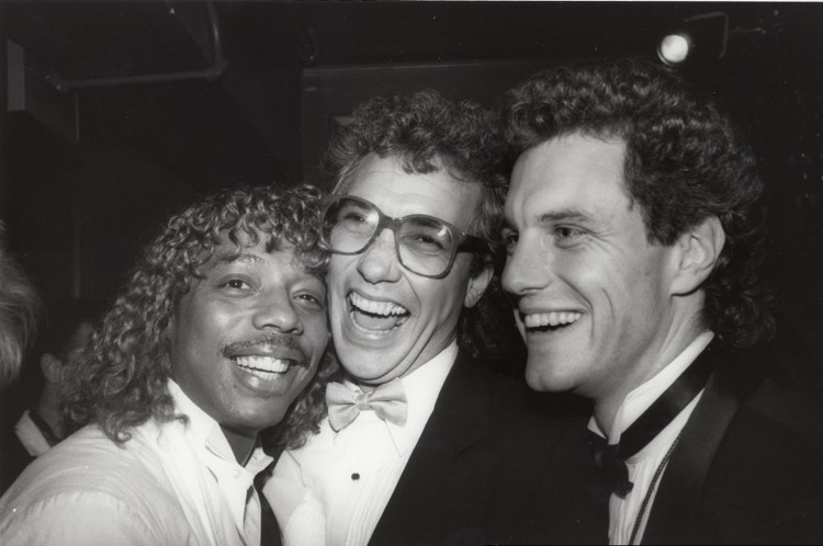 MTV co-founder Les Garland (c) laughs with Rick James and exec John Sykes
