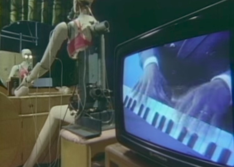 Still from Herbie Hancock's 'Rock It,' a popular video on MTV in the 80s. A famous DJ cited this video as an example of MTV's racism in the era.