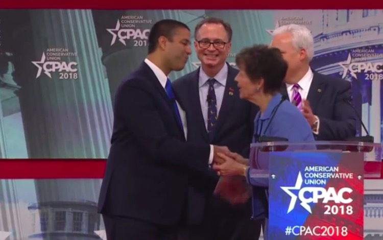 FCC Chairman Ajit Pai accepts the 'Charlton Heston Courage Under Fire' award from the NRA at CPAC 2018.