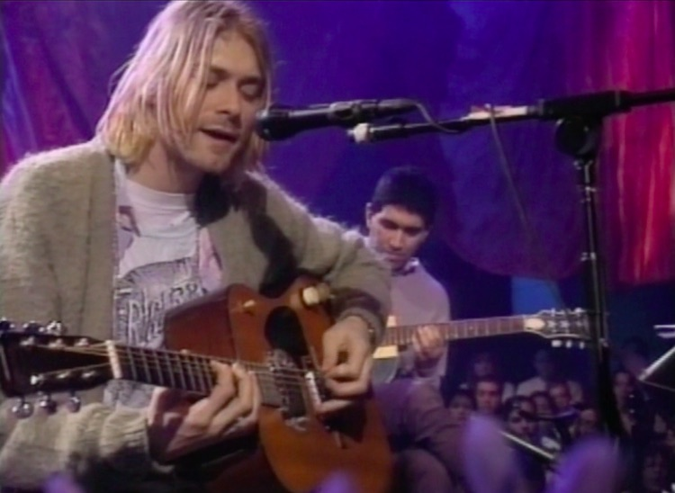 Kurt Cobain of Nirvana plays his 1959 Martin D-18E for the last time in 1993 on MTV's Unplugged.