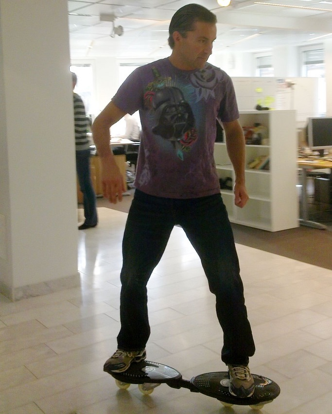 Spotify executive Martin Lorentzon seen casterboarding around the office