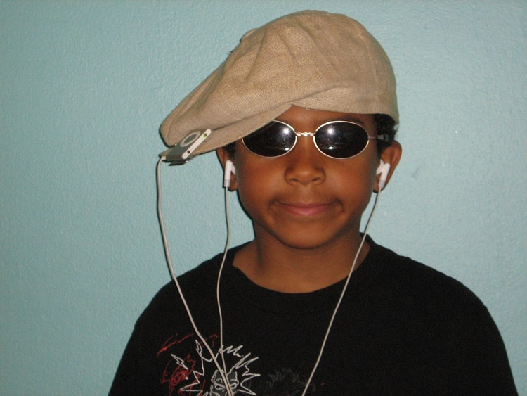 Kid listening to music downloads on an iPod shuffle