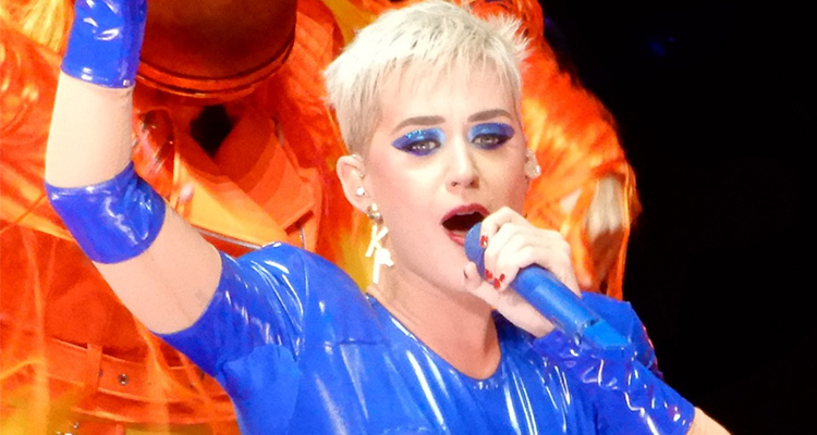 Katy Perry at Madison Square Garden holding a blue microphone in 2017