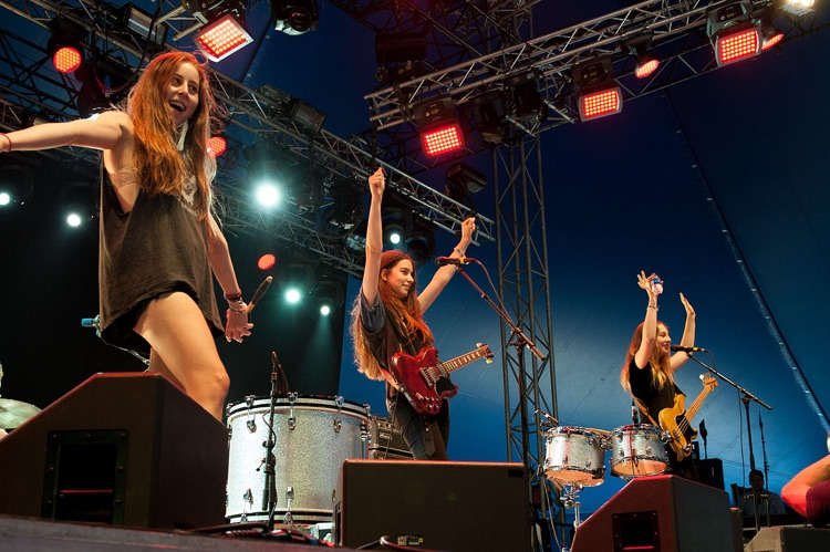 HAIM Says a Male Group Got Paid 10 Times More by a Festival