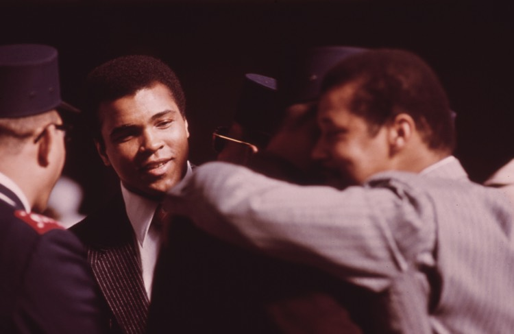 World Heavyweight Boxing Champion Muhammad Ali attends a sermon of Elijah Muhammad, Chicago, 1974 (U.S. National Archives)