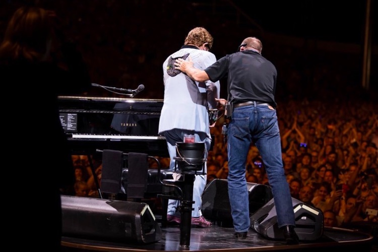 Elton John Tearfully Assisted Off Stage After Voice Fails Due to Pneumonia