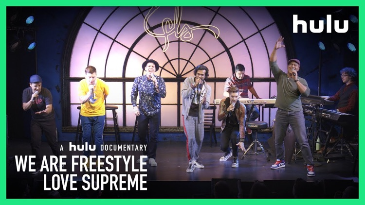 A promotional image for the newly released Hulu Original 'We Are Freestyle Love Supreme,' showing the namesake improv hip-hop group performing live.
