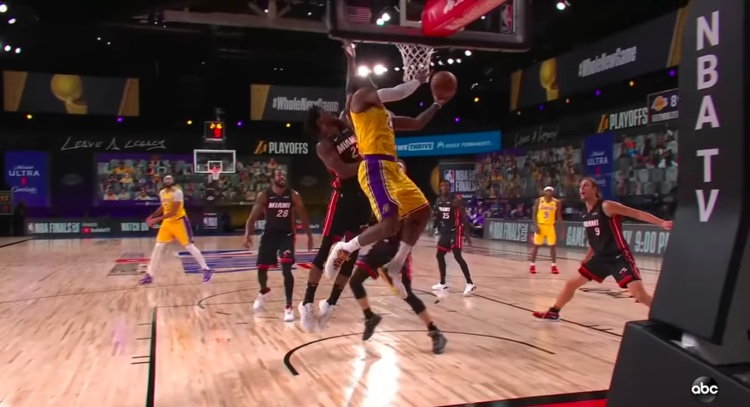 The Lakers' Lebron James scores against the Miami Heat in an NBA Finals Game 1 match-up.