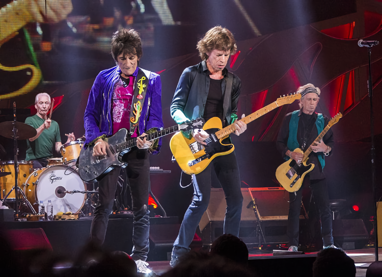 How old are the The Rolling Stones? Ronnie Wood is 74, Mick Jagger is 78, and Keith Richards is 77. Charlie Watts (on the drums) passed away at 80.